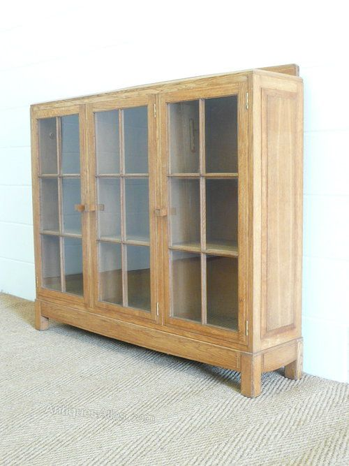 """An Arts & Crafts Cotswold style """"Gower"""" oak bookcase, designed by Paul Matt for Brynmawr Furniture dating circa 1930. Labelled."""