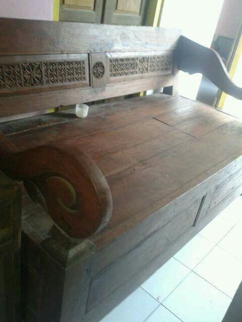 Javanese Race Bench / Resban / Bangku Beti. It's a teak wooden bench. Simple Carvings. Mostly found in Kudus and Demak towns. It has a box under for ancient people's stuff storage.