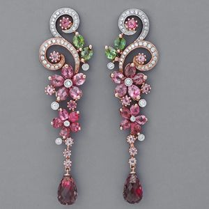 I'm not usually attracted to really girlie jewelry, but these art nouveau style earrings make me salivate.