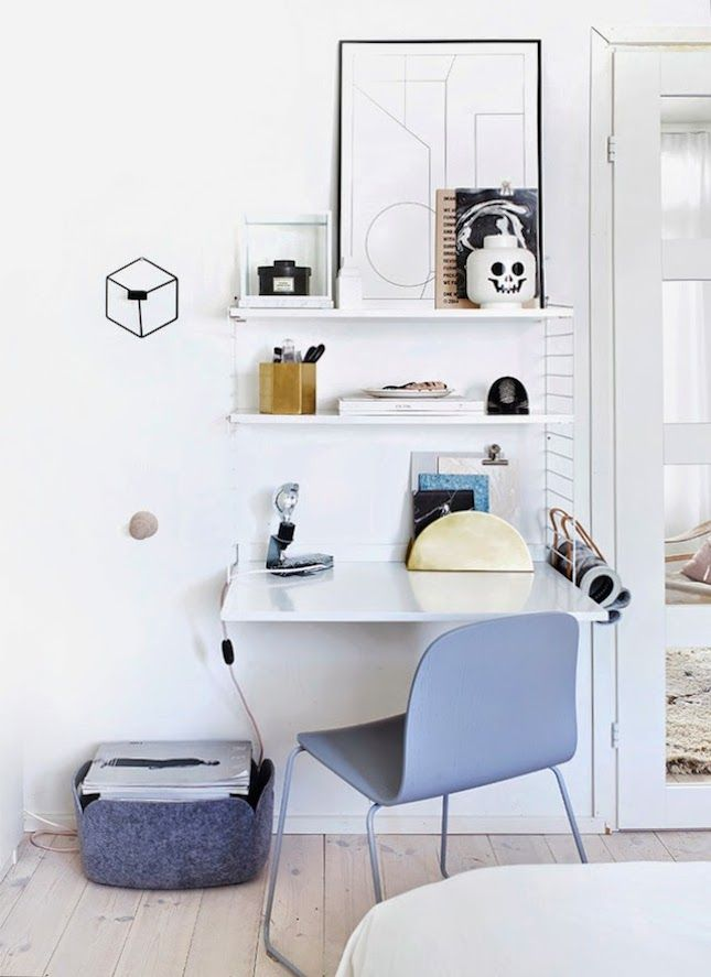 Add floating shelves to your work area.