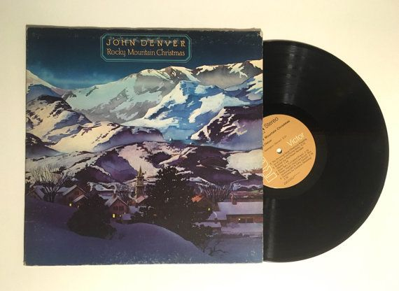 John Denver ‎– Rocky Mountain Christmas  Label: RCA ‎– APL1-1201, RCA Victor ‎– APL1-1201 Format: Vinyl, LP, Album, Gatefold Country: US Released: 1975 Genre: Folk, World, & Country Style: Folk  Tracklist  A1 Aspenglow A2 The Christmas Song (Chestnuts Roasting On An Open Fire) A3 Rudolph The Red-Nosed Reindeer A4 Silver Bells A5 Please, Daddy (Dont Get Drunk This Christmas) A6 Christmas For Cowboys B1 Away In A Manger B2 What Child Is This B3 Coventry Carol B4 Oh Holy Night B5 Silent Night…