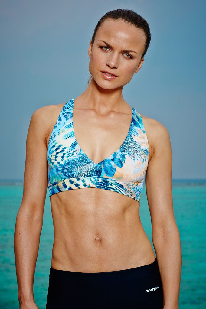 I am Fearless Lily Bra This feather print I am fearless, is unique for SS15. The lily bra is a  supportive and comfortable sports bra and is essential, whatever the workout. This Lily bra will sculpt to your body for maximum support and is specifically designed with  a flattering silhouette in mind.  Available now for £60 at http://www.bodyism.com/product/fearless-lily-bra-ss15/