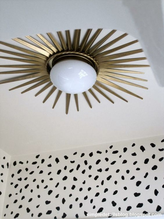 Install a starburst mirror frame around a flush mount ceiling light for a dramatic makeover!