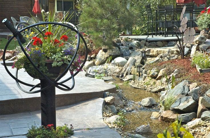 Garden Kaleidoscope next to a babbling brook, what a beautiful backyard!