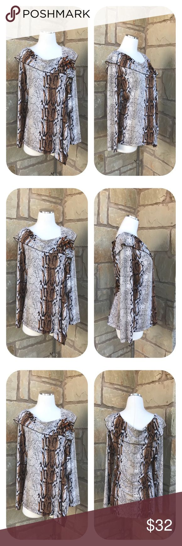 """Mishca Long Sleeve Animal Print Embellished Blouse Mishca Animal Print Long Sleeve Blouse Size M  -  Long Sleeve -  Beautiful Stone Detail on Front -  96% Polyester 4% Spandex -  Size M     Armpit to armpit 18""""     Armpit to end of sleeve 20""""     Shoulder to hem 27""""  Thanks for visiting! ❤️ Mishca Tops Blouses"""