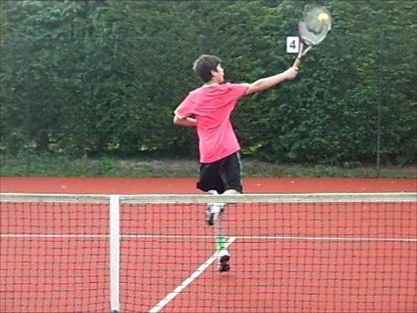 One of my sons playing tennis. It's hard to accept he looks so athletic in this picture as I've seen him getting out of bed in the mornings.