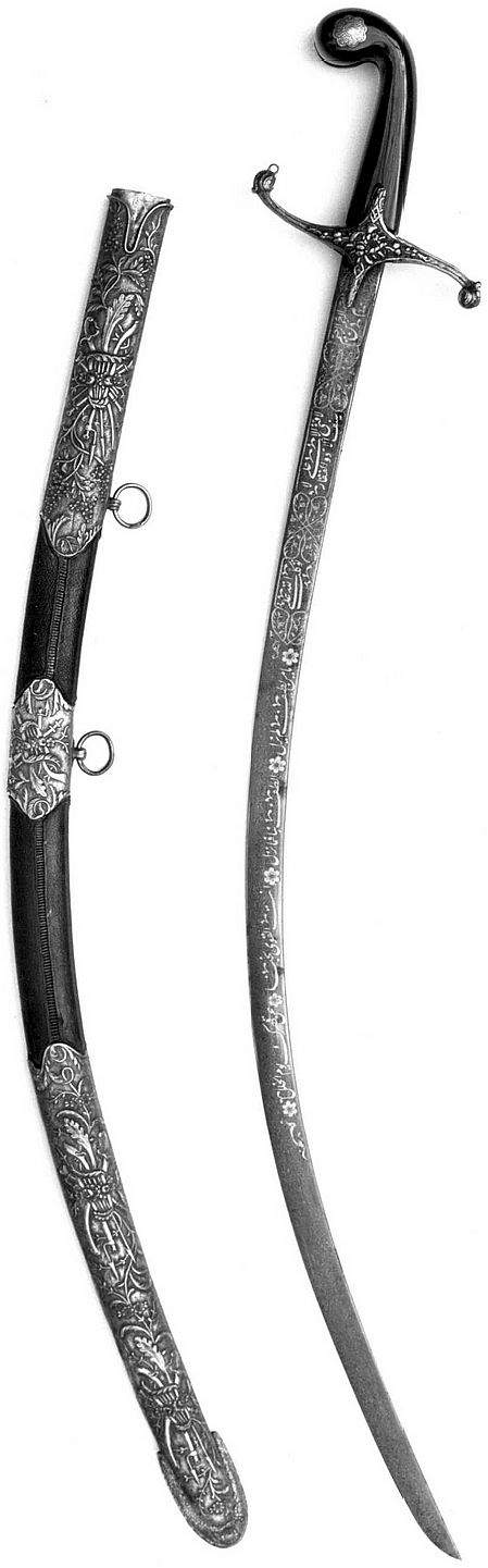 """Ottoman kilij (saber), 19th century. The blade is signed by its maker, Acem Oglu. The Arabic inscriptions decorating it include: """"Oh from the gentle God whose gentleness is without end, You are the Powerful, we will love You in Your palace on the day of judgement."""" The foliate ornament on the guard and scabbard mounts shows the strong influence of European design in Turkish art of the eighteenth and nineteenth centuries. Bequest of George C. Stone, 1935, Metropolitan Museum of Art."""