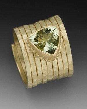 Gayle Eastman | Gold rings with hammered texture and set with trillion cut stone.