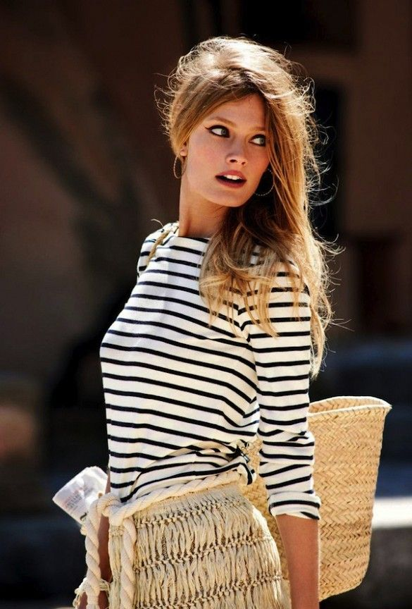 Constance Jablonski photographed by Cedric Buchet for Elle France wearing a striped top and raffia skirt