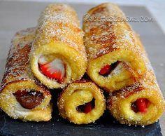 Pain perdu revisité Ingrédients : - 2 œufs - 6 cuil. à soupe de lait - 1 sachet de sucre vanillé - Du Nutella - Des fraises ou des bananes - Du beurre (pour la poêle) Préparation : - Aplatir les tranches de pain de mie et enlever la croûte - Étaler fruits et Nutella sur un des côtés du pain de mie - Rouler chaque tranche et les tremper dans un mélange oeuf + lait + sucre - Dorer les roulés sur une poêle bien beurrée