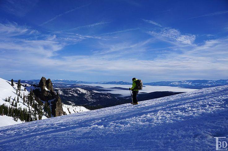 hiker along the ridgeline, above the fog
