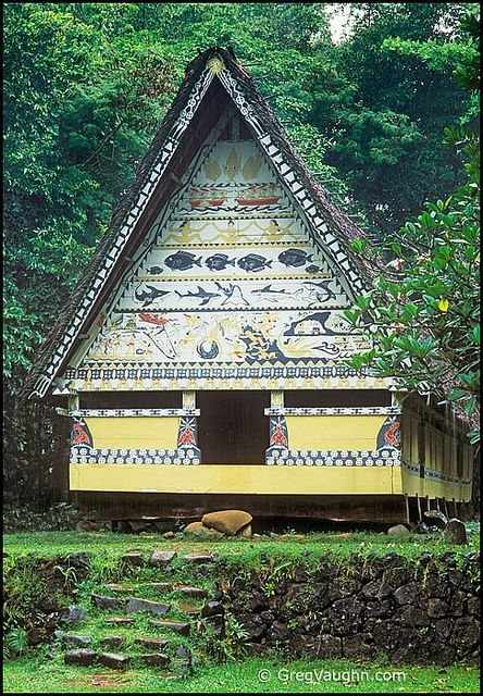"Palau, Micronesia: a ""Bai"" - Palauan communal meeting center - constructed in the traditional style, with painted legends over entry; at Palau National Museum, Koror."