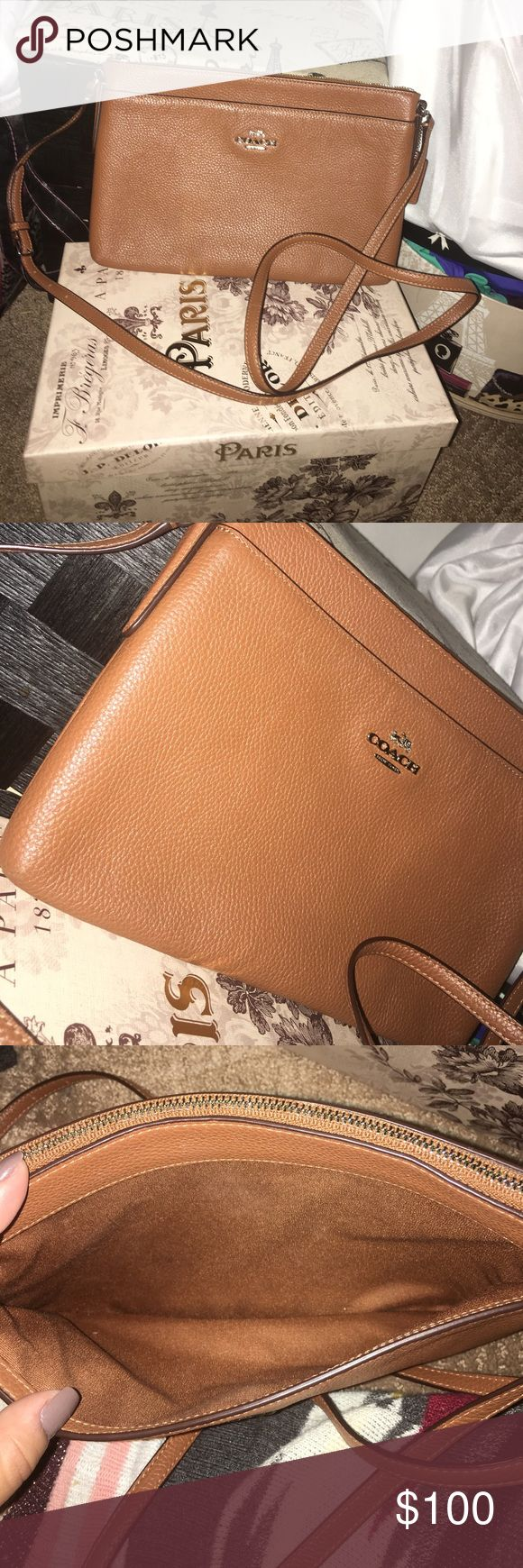 🌺COACH swingpack 🌺 Saddle brown swingpack. Silver hardwear! Excellent condition. Purchases at a full retail coach store about a year ago but only used for a week. Been sitting in a storage box since. Silver accents aren't for me. Needs a new home :) Check out bundle deals and my other coach listings! Coach Bags Crossbody Bags