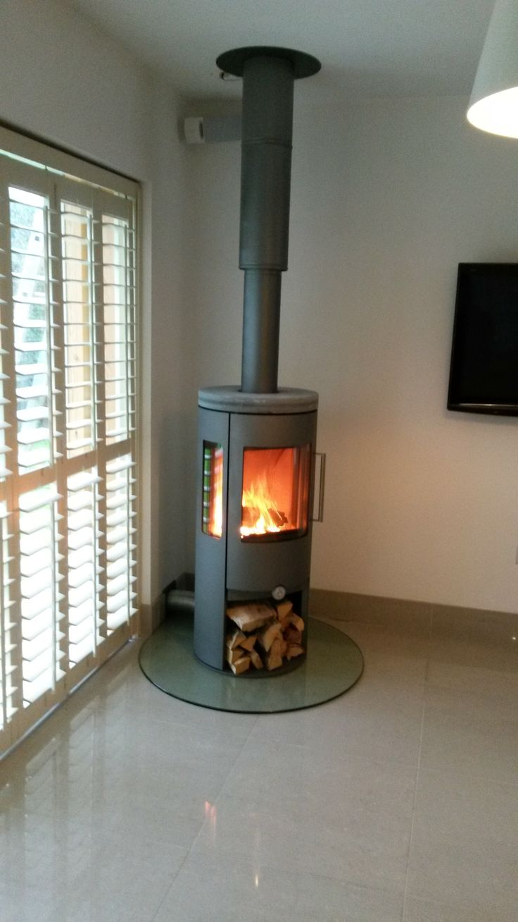 Dan Skan Nuro 120 with Side Glass, Log Store and Soapstone Top Plate. Plate Glass Hearth