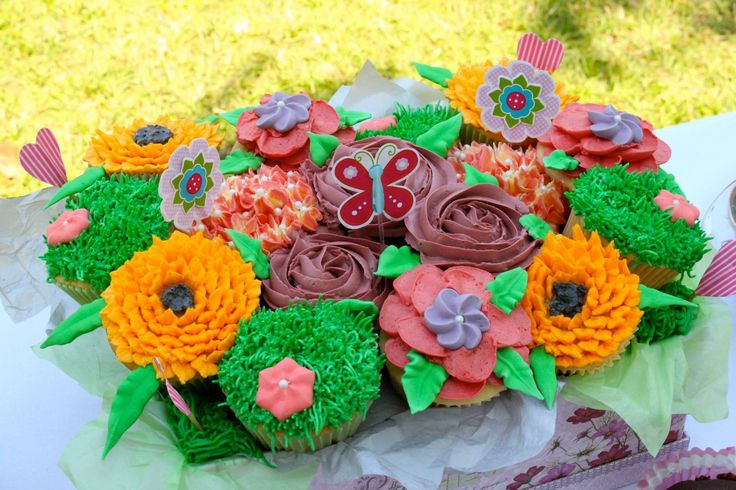 Box full of cupcake flowers #cupcakebouquet