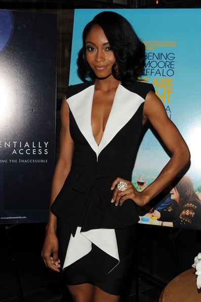 Yaya DaCosta Short Curls  Yaya DaCosta paired her structured black and white suit with short curls.