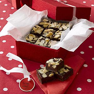 """Chocolate-almond Fudge Squares. """"This rich, chocolate-almond fudge does not require a candy thermometer and is a great choice for holiday gifts."""""""