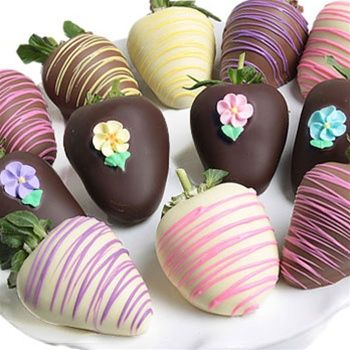 Chocolate Covered Strawberries. Each strawberry is hand-dipped in an assortment of delicious milk, decadent dark, and heavenly white Belgian chocolates. They are then artfully decorated with handcrafted flower candies and a signature pink, yellow, and purple confection drizzle. Each assortment is carefully packaged in a beautiful gift box.