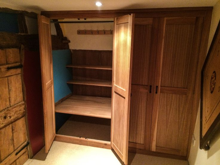 Sloping Ceilings Behind A Bespoke Fitted Solid Oak Wardrobe Provide Additional Storage Options Solid Oak Wardrobefitted Bedroom Furniturefurniture