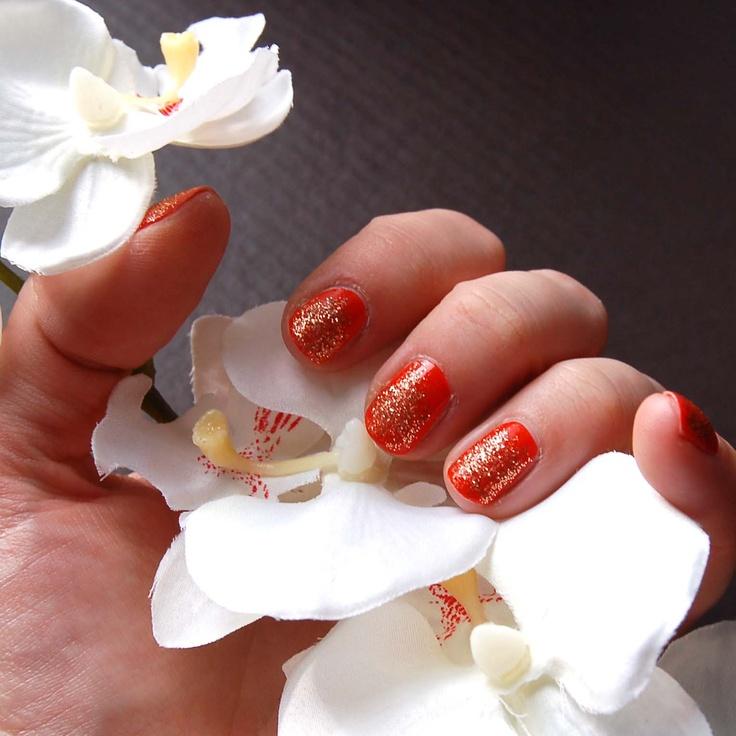 My nail art. Gold glitters and coral red nail polish.