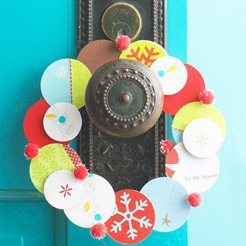 Holiday card wreath hanging on door knob