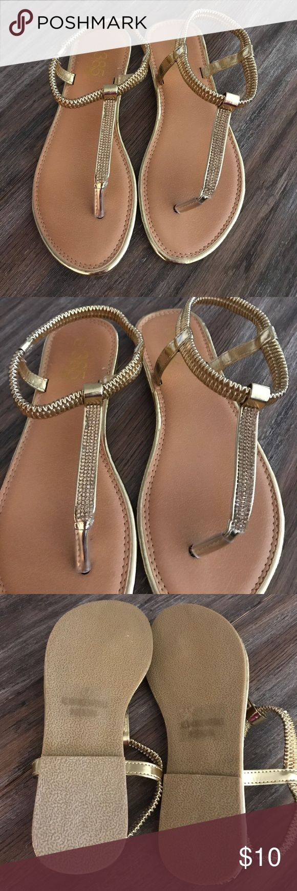 Brand new WOT gold sandals FINAL PRICE DROP These gold sandals have only been tried on, never worn. Brand new condition without tags. Perfect for casual wear, beach wear or even with a nice dress. Very minimal heel as shown in last picture. 385 Fifth Shoes
