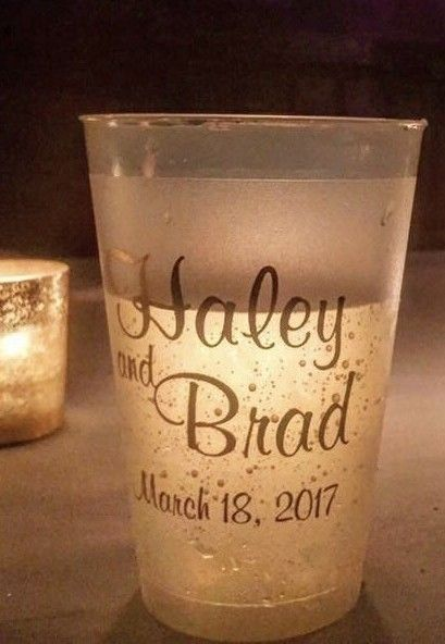Attractive as they are functional, personalized shatterproof frosted plastic cups can be used at your drink station, alcohol bar, punch stand or outdoor beer station. We love how the background candlelight illuminates the bride and groom's name in this beautiful shot. These cups can be ordered at http://myweddingreceptionideas.com/14_ounce_shatterproof_frosted_plastic_cups.asp