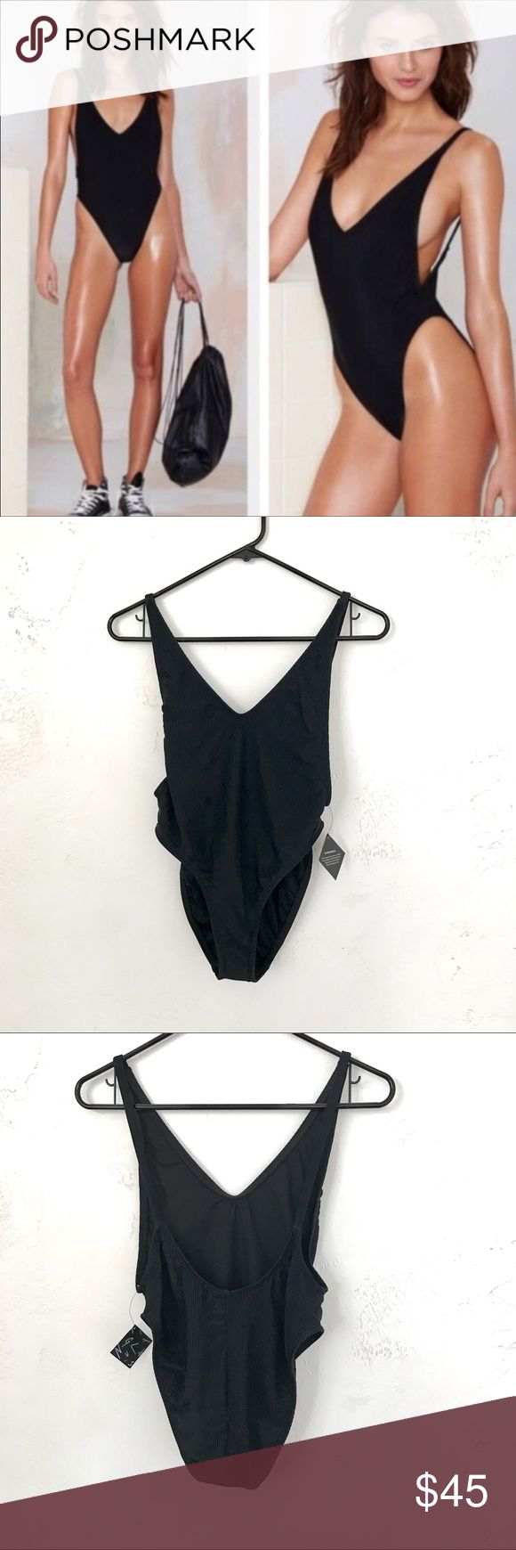 NastyGal Alina Black One Piece Brand new with tags. Such a sexy suit I just need a bigger size! Fabric is robbed and very stretchy! Beautiful scoop back and plunging sides for optimal side boob. This is a 2 and it's definitely a 2! Would recommend for someone an XS/S. At the moment im more of a S/M and it's too small. I checked it out and it has a small snag on the front which is pretty small and unnoticeable and not running but I believe it happened in the shipping process. This is…