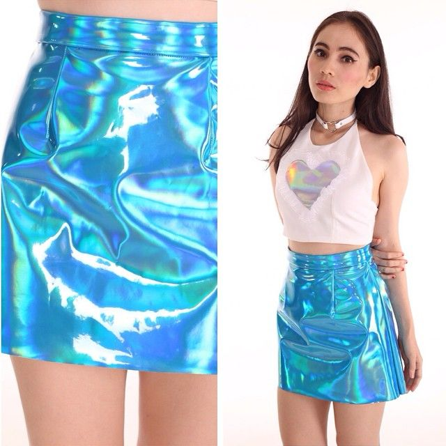 This is an example of a contemporary application of the cyber punk trend of the 1990s. The material looks plastic while also being iridescent, with a holographic heart tank to accompany it. Finally it is worn with a leather choker, all popular looks in the 90s. 4/5/15