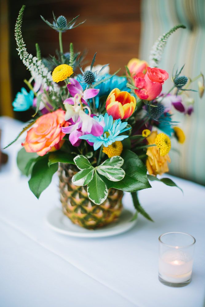 Elvis' Blue Hawaii mixed with a little Endless Summer and a touch of Mad Men inspired Candice and Charlie's San Diego wedding. They wanted their wedding to feel like a retro beach party and their venue, The Pearl Hotel, was the perfect setting for this.