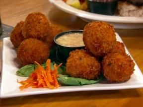 Saw this on Diners Drive-ins and dives.... Chris was salivating. I must make...Fried Reuben Balls with Horseradish Dipping Sauce