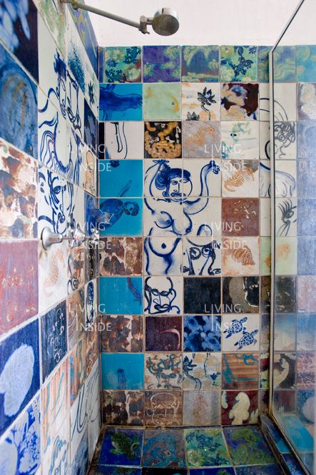 a complete hodge-podge of tiles in the shower