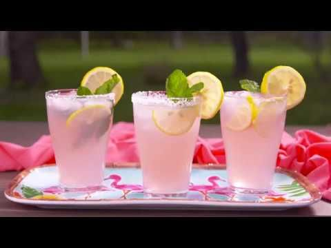 Lemon wedge, for rimming glasses Coarse salt, for rimming glasses 2 c. ice 2 c. Pink lemonade 1/4 c. fresh lemon juice 1/4 c. triple sec 1 c. tequila 4 Lemon Slices, for garnish