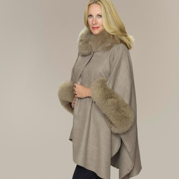Plumes of dreamy Alpaca fur, outline this sensational buttoned cape.   Made in 100% luxuriously soft Alpaca Relaxed fit One Size  SaveSaveSaveSaveSaveSaveSave