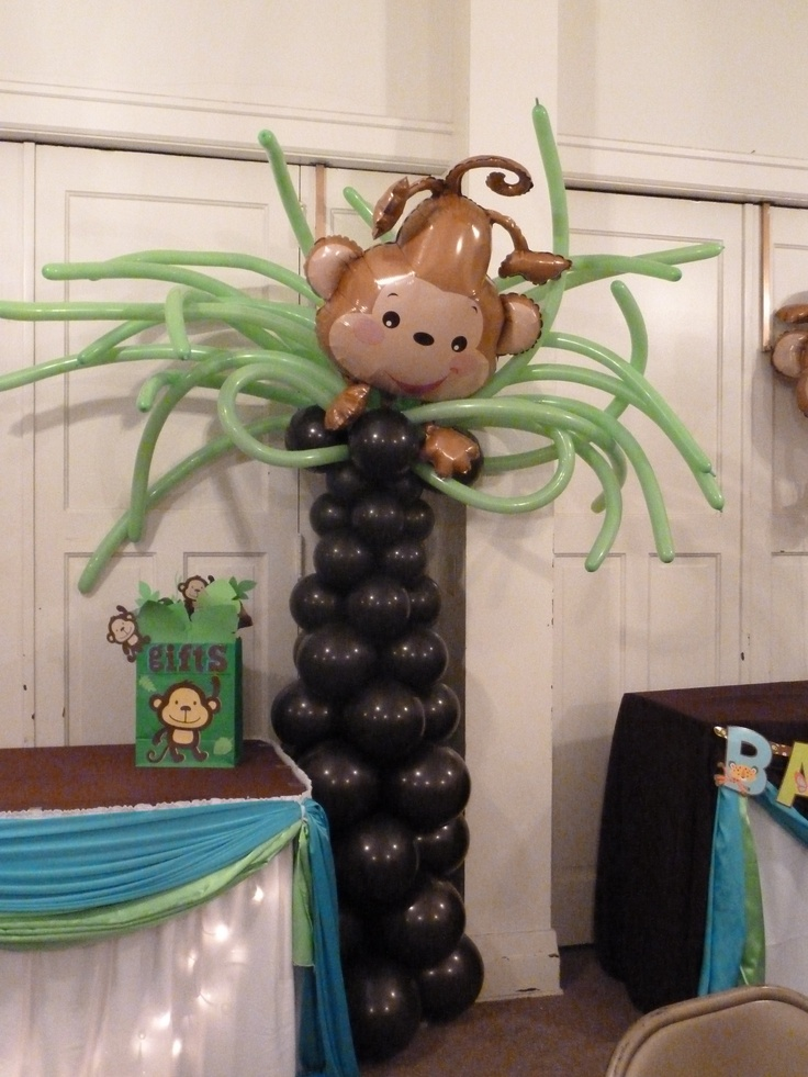 I like the palm tree with balloons! Could do for beach theme party. Monkey Themed Baby Shower