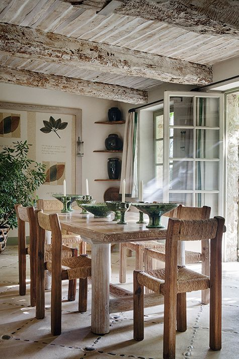 """Of this area in his Provence home, Francois Catroux says, """"We are not often in this room because the idea is to always be outside. But fortunately this is the room you have to pass through to get outside, so we see it every day. It's more like a gallery than a dining room."""""""