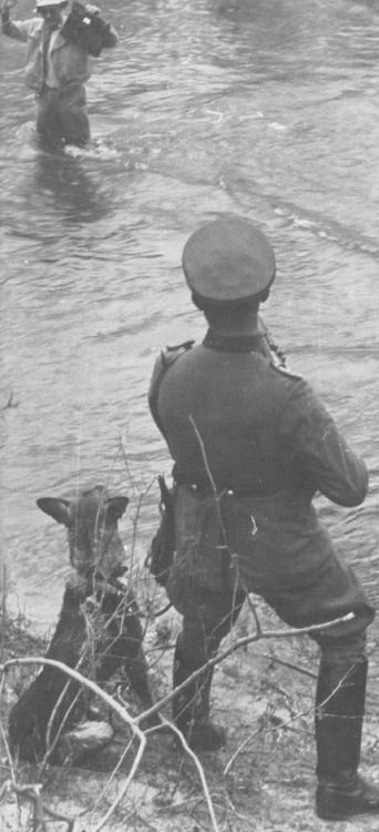 """A Swiss border guard intercepts a border jumper coming from France. Although Switzerland did shelter several hundred thousand refugees during the war, their policy was not without controversy, most especially with the policy of refusing entry to most of the French Jews who attempted to flee into Switzerland following Fall Gleb, with the infamous explanation that """"the lifeboat is full"""". Many border guards began turning a blind eye however after some bad experiences."""