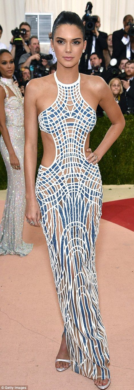 Statuesque: Kendall Jenner sizzled in a Versace gown with sexy cut-outs...