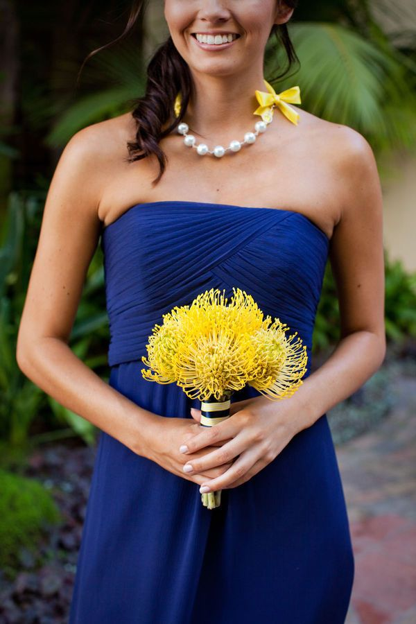 Blue and Gold wedding, thank you!  @Jessica Johnson @Suzie Sharpe Bridesmaids? Not a fan of those flowers. :-/