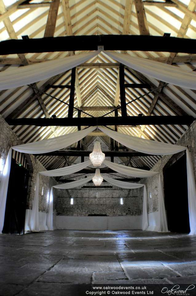 Drapes and chandeliers at the Monks Barn Hurley for a summer wedding