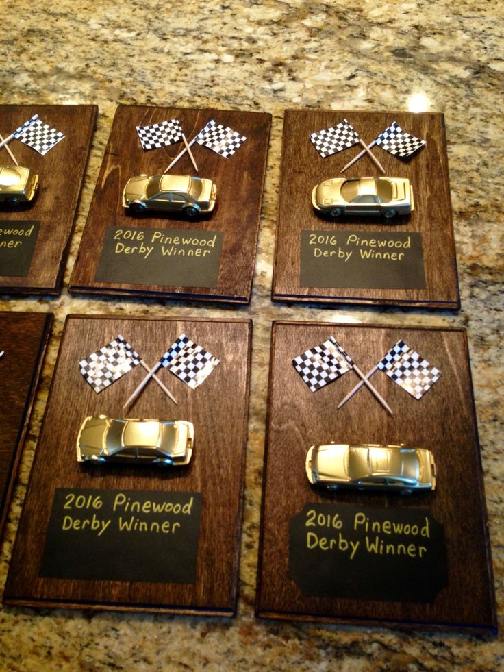 I'm excited about how the prizes for the Pinewood Derby winners. I used a .97 cent plaque from Walmart, chalkboard labels & 3 packages of dollar store cars, & some racing flags I had.  I stained the wood, sprayed with polyurethane coat, sprayed the cars gold(actually my son did that). I hot glued car & flags onto the board. Lastly, I wrote with permanent chalk markers & will fill in the winners names tonight. I hope the boys like them!