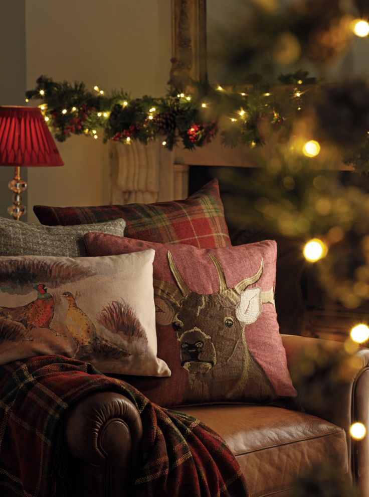 Rich berry hues and an assortment of cushions create that festive, cozy atmosphere.  (Christmas decor)