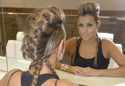Braided faux hawk. This site is in Spanish but I love her hair.