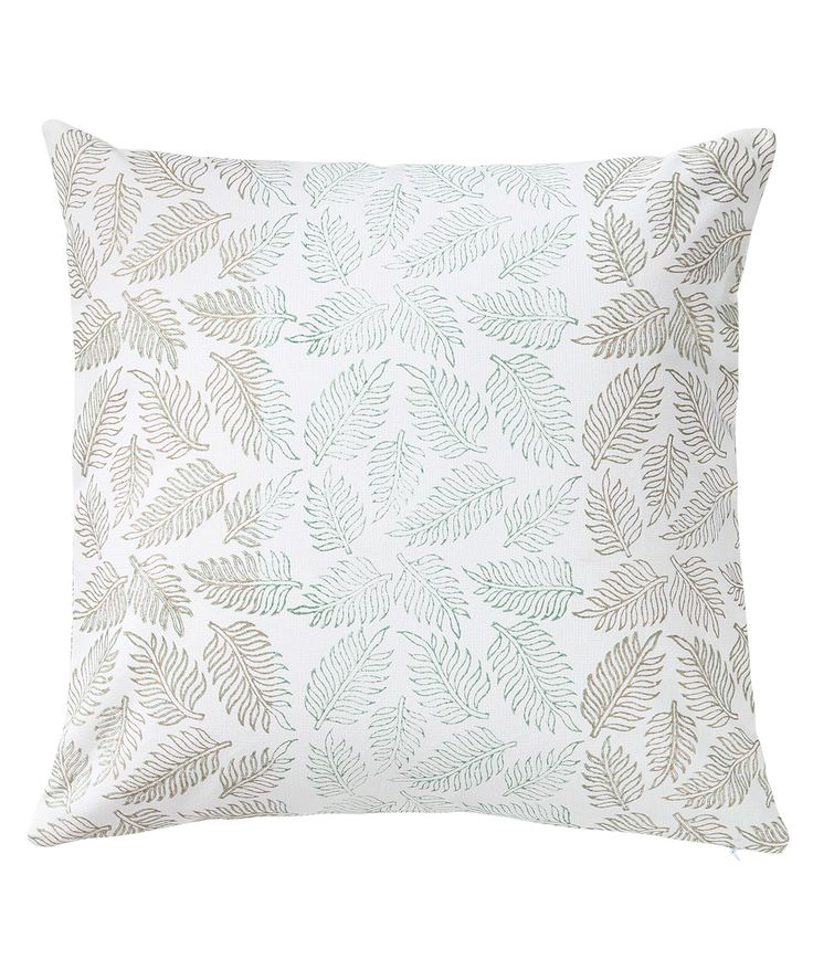 The leaf design is block printed in earthy shades of green and brown. The cushion reverses to the same design. www.theindianpick.com