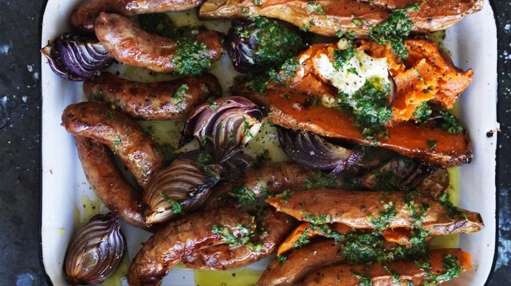 One-tray wonder: Baked sweet potato and sausages with salsa verde and sour cream