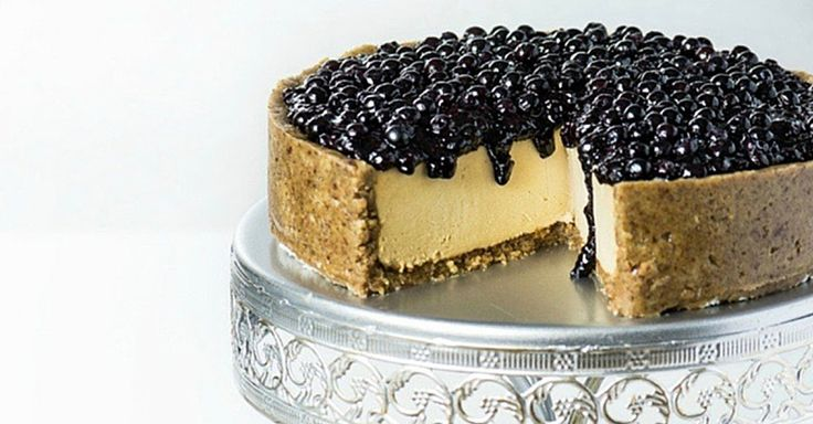 A decadent, rich, and creamy cashew cream cake topped with blueberry chia seed jam. - Fitnessmagazine.com