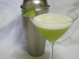 Key Lime Martini   (1 1/3 oz Vanilla vodka   1 oz. Rum  1 oz. Midori  1 oz. Lime juice  1 oz. Pineapple juice  1 Teaspoon simple syrup)