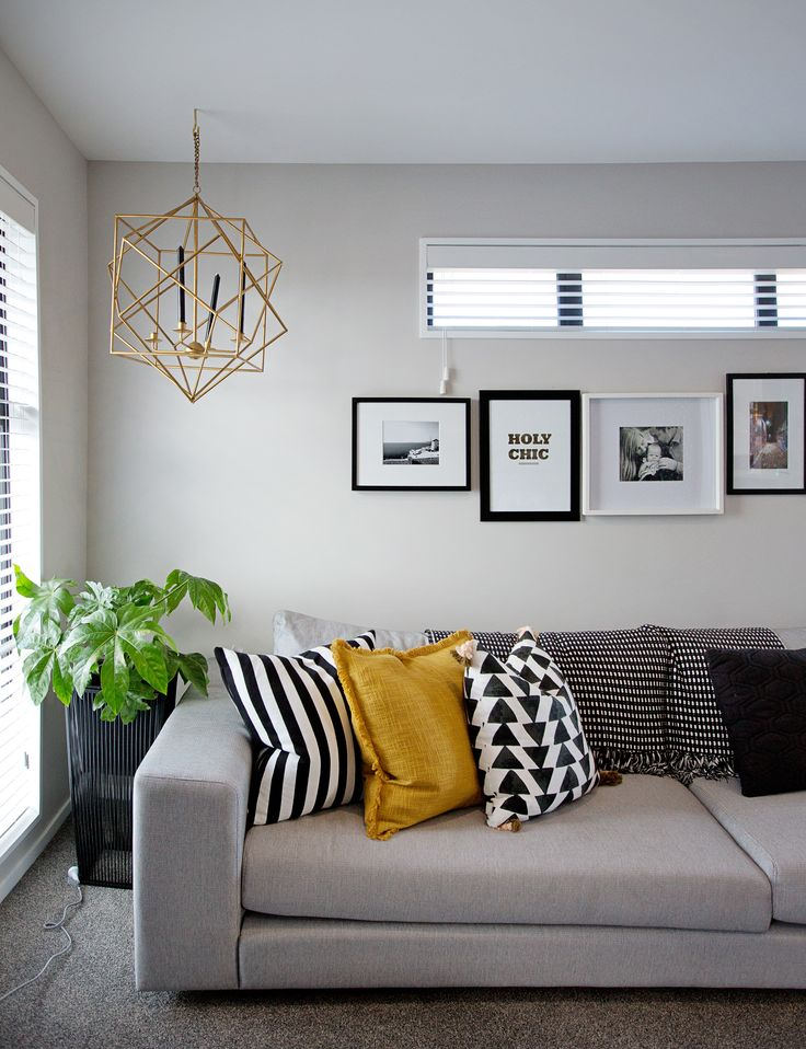 Cushions, a light, and bring back plants - all make an impact.