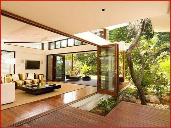 Accordian doors separating indoor/outdoor. Gorgeous wood floors!