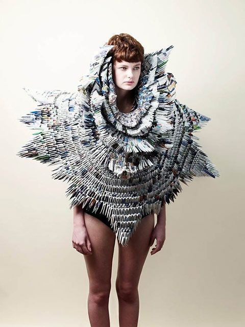 """At a World Wildlife Fund charity event in London, textile based sculptor Rowan Mersh showcased a dress he made out of old WWF magazines, using a traditional origami technique. The wearable sculpture was designed in aid of the fundraising event to protect wildlife and habitats, tackle climate change, and promote sustainable ways of living."""